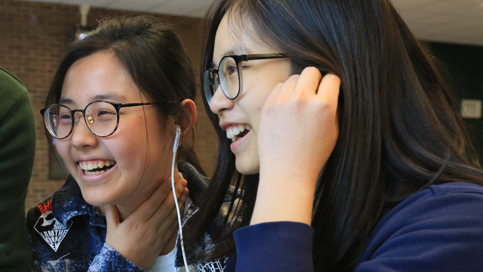 Two laughing international students