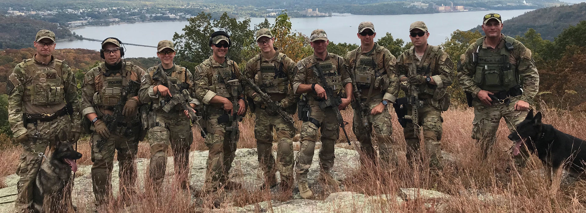 Justanna Bohling is pictured with her fellow Special Operations Group following a mission to search for a fugitive wanted for murder.