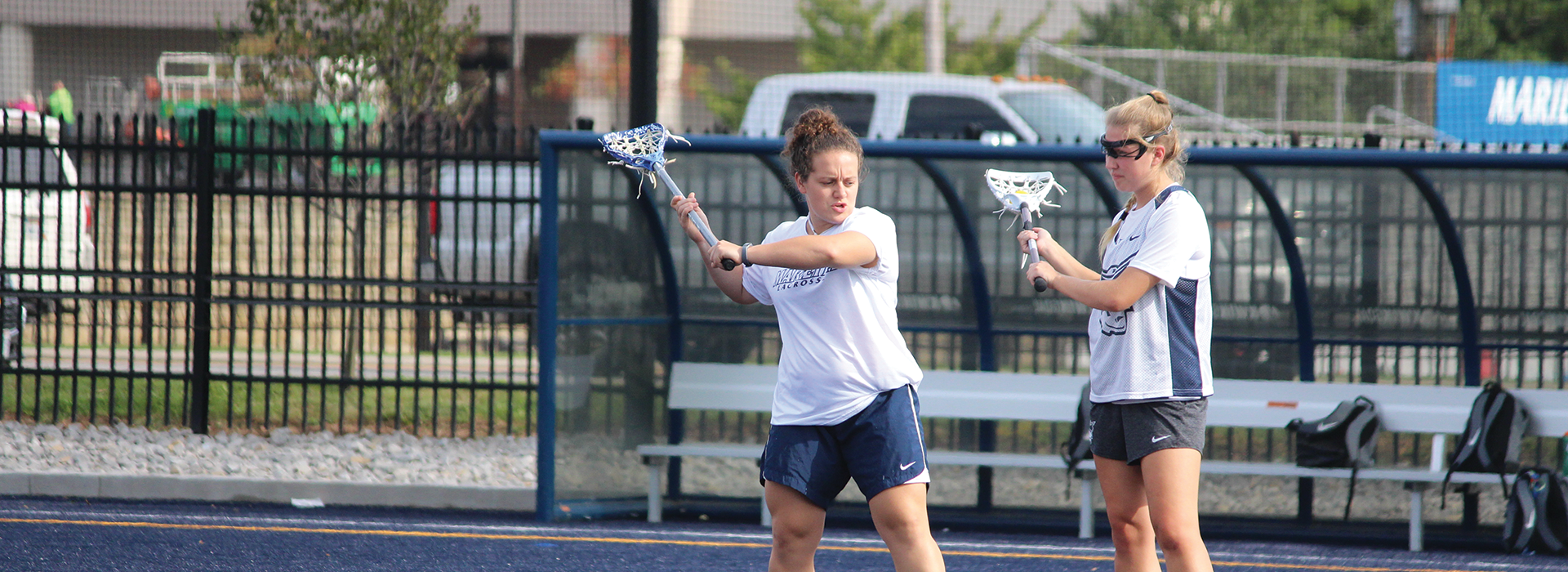 Jordan Anderson '17 provides a few pointers as the assistant women's lacrosse coach for Marietta College. Photo courtesy of Jeffrey Schaly, Marietta College