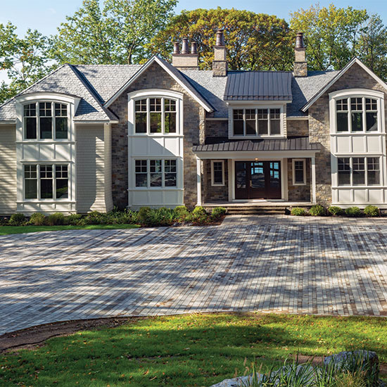 The workmanship of Lasnicki's landscaping and hardscaping gleams in this home on Skaneateles Lake.