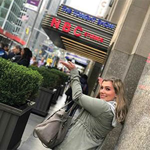 Rachel Jackson is pictured outside the famous NBC sign in New York City.
