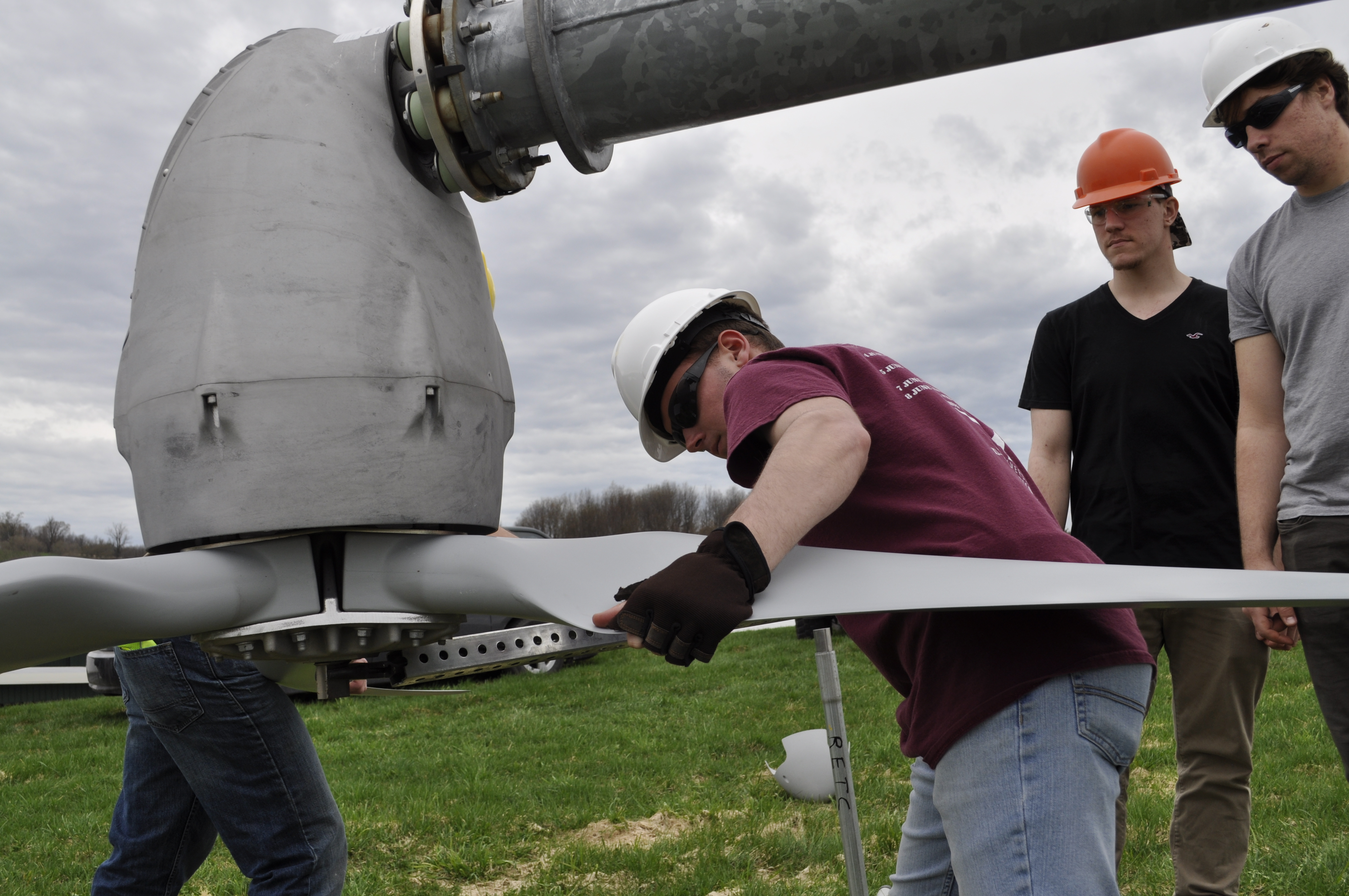Students work on the college's wind turbine