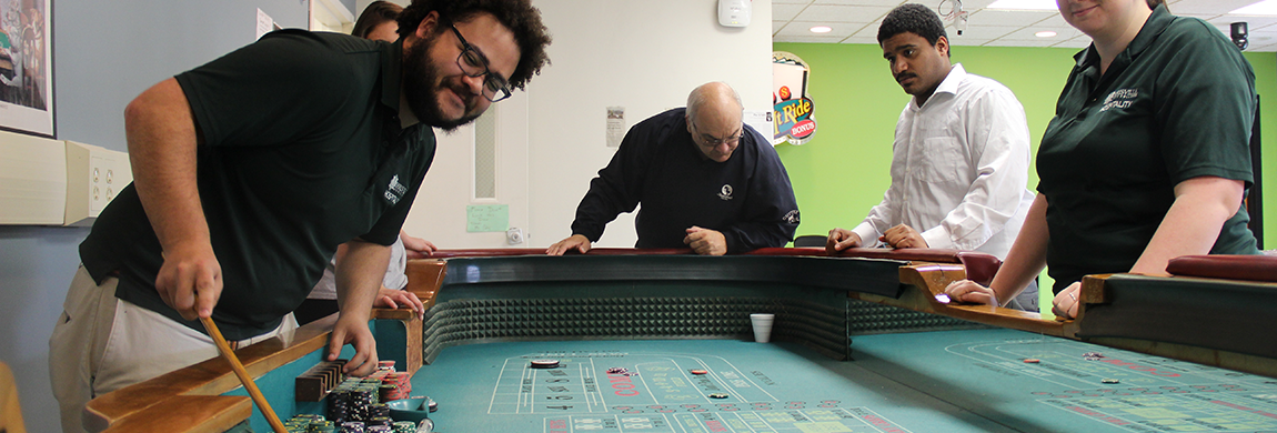 Students working at a craps table