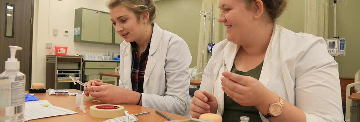 Students working with syringes