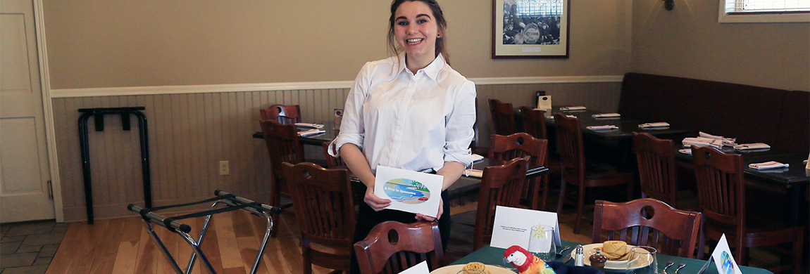 Dietetic Technician setting up a dining table