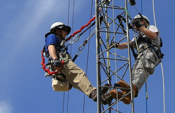 Students climbing an electrical thing
