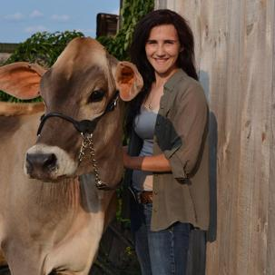 Carrie Shuman with a cow