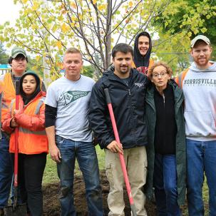 group of students partaking in tree planting