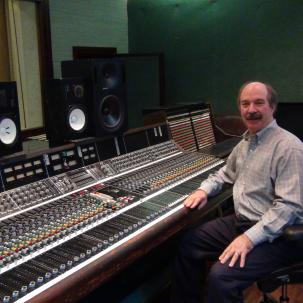 Larry Droppa in a recording studio with one of his API consoles