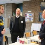 Richard Ball, commissioner of the New York State Department of Agriculture and Markets, speaks with Jacob Kline, an agricultural business student from Myerstown, Pennsylvania, and Christopher Nyberg, Dean of the School of Agriculture and Natural Resources.